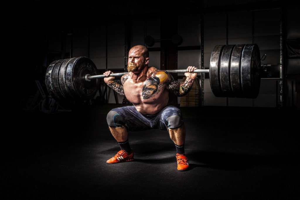 weight lifter squatting